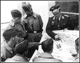 German pilots get a briefing prior to a mission